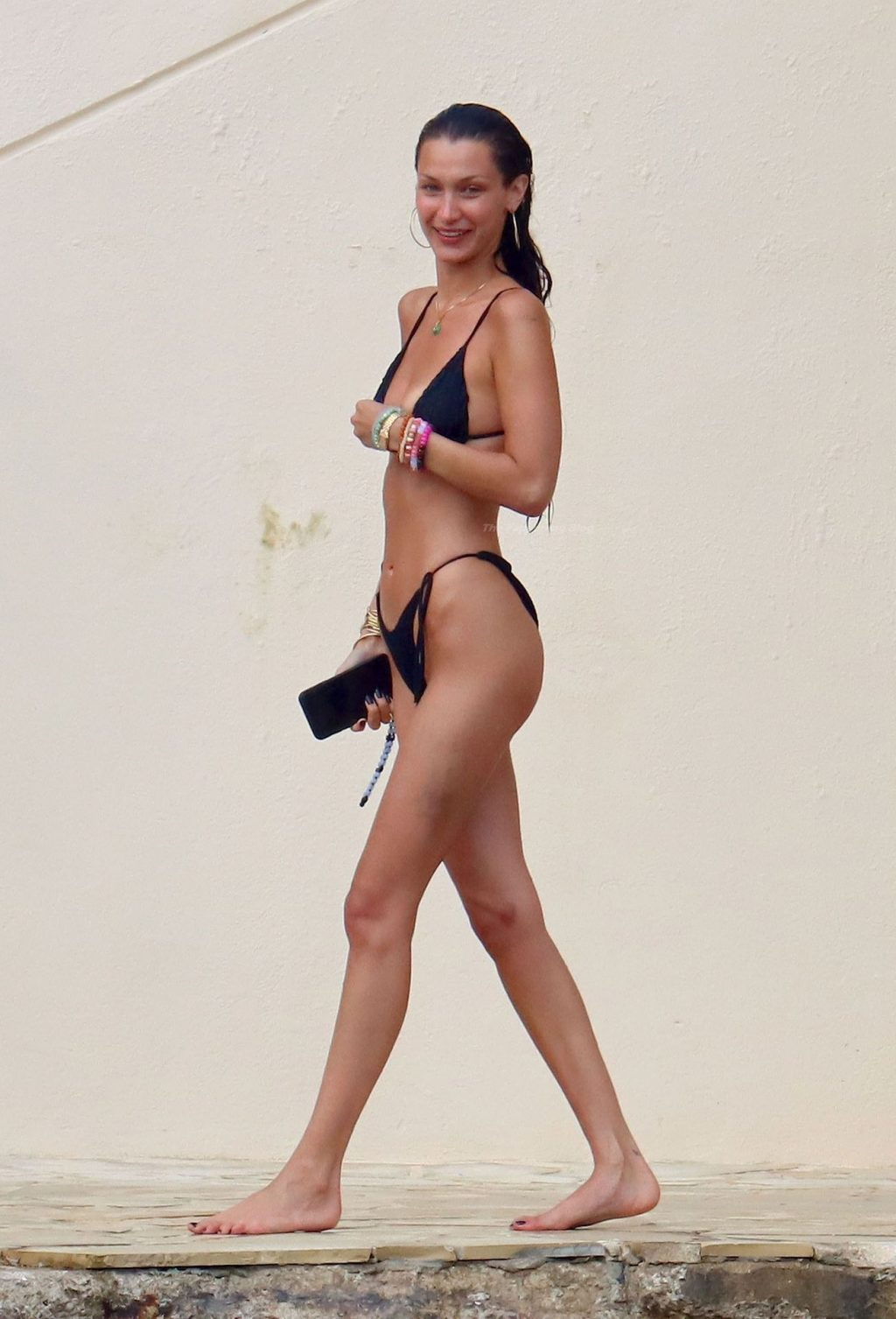 Bella Hadid Shows Off Her Svelte Physique Wearing a Black Bikini Out On Holiday at Eden Roc (46 Photos)
