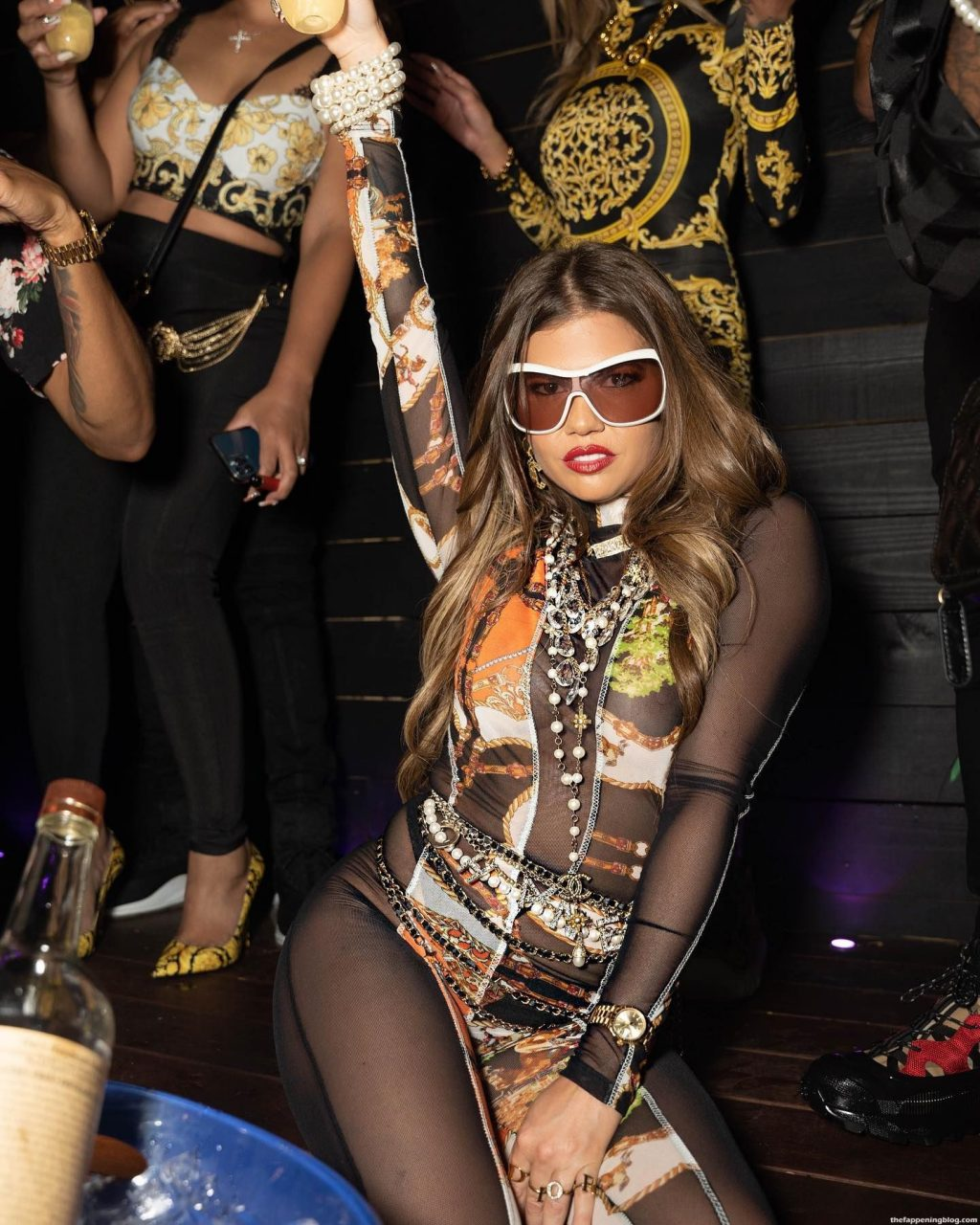 Chanel West Coast Flashes Her Nude Tits at the Club (9 Photos)