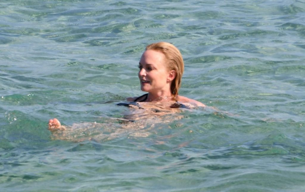 Heather Graham Puts On a Black Bikini Show Out On Her Holiday in Sardinia (18 Photos)