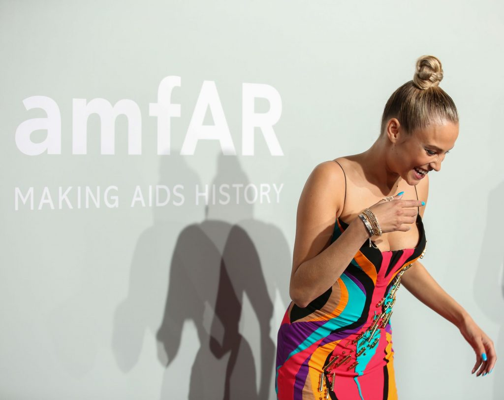 Rose Bertram Shows Off Her Cleavage at the 27th AmfAR Gala in Cannes (16 Photos)