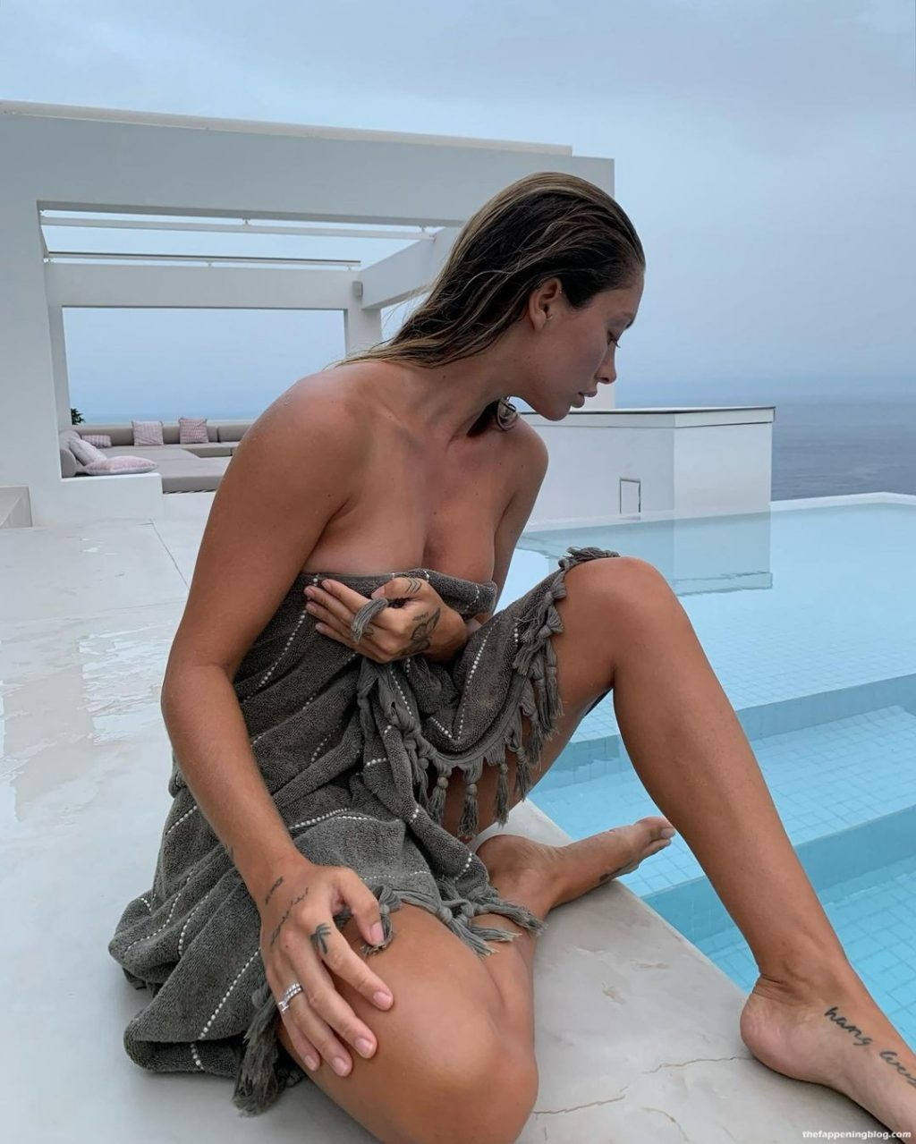 Pauline Tantot Poses Topless in The Pool (3 Photos)
