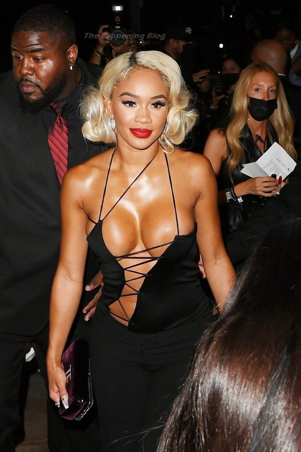 Saweetie Shows Off Her Boobs in a Lace-Up Barely There Blouse at the Tom Ford Fashion Show (37 Photos)