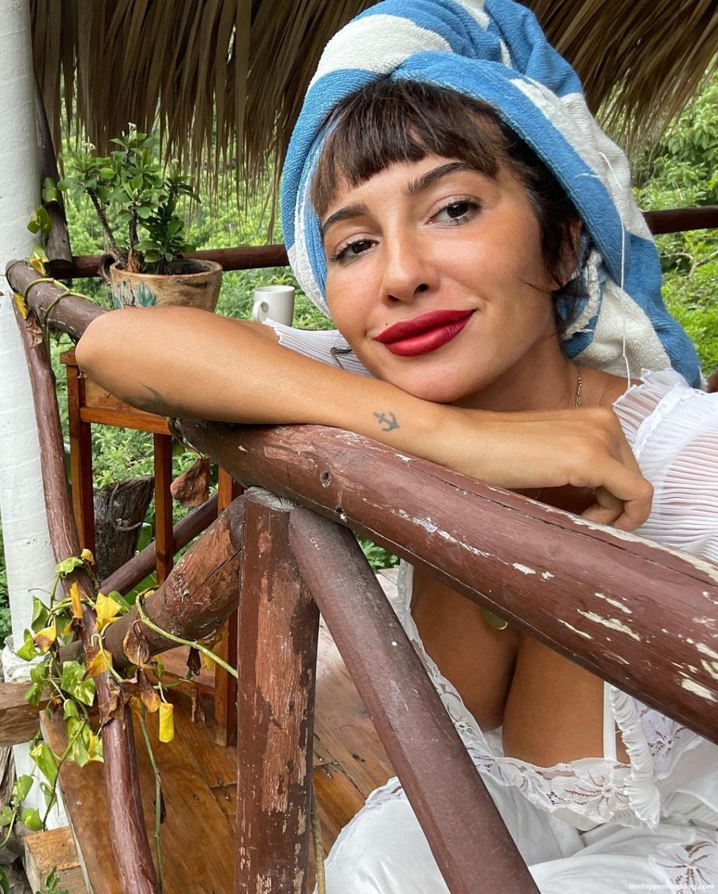 Jackie Cruz Shows Her Sexy Legs and Tits in a White Dress (5 Photos)